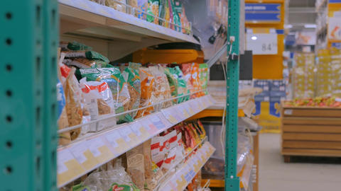 Woman buying dried fruits at supermarket Footage