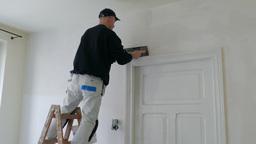 Room renovation. Plasterer at work 1 Footage