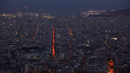 Aerial Barcelona perspective at night, dusk crowdy cityscape, bright street line Footage