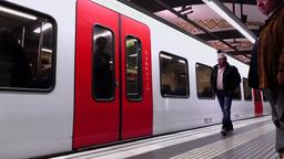 Train arrive at subway station platform, doors open, passengers go inside Footage