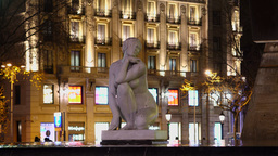 La Deessa, white marble sculpture of Goddess, night time, against building Footage