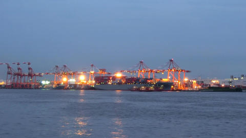 Time lapse of a ship loading and preparing for departure at Tokyo's twilight wat Footage