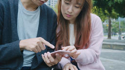 Young couple watching on smartphone Footage