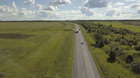 Highway road traffic in a valley . Aerial shoot of a highway road with traffic Footage