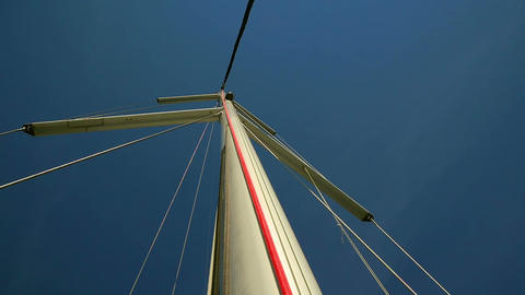 Sailing boats main mast with windex and supporting steel ropes Footage