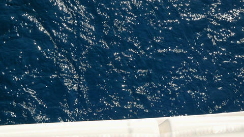 Closeup on blue Adriatic sea water comming from below of sailing boat. Standing Footage