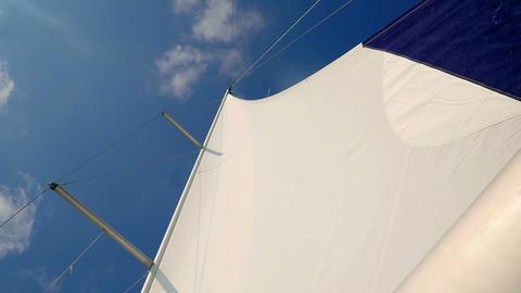 Sailing boats main mast and sails with wind indicator at edge of sail Live Action