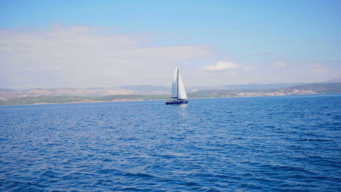 Croatian Adriatic seascape wit beautiful blue sky and clouds and sailing boat Footage