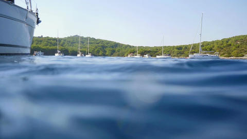 Swimming beside sailing boat and filming under water in slow motion hd Footage