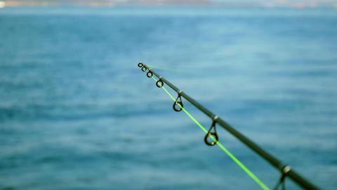 Big game fishing in Adriatic sea showing fishing rod fixed on back of the boat Footage