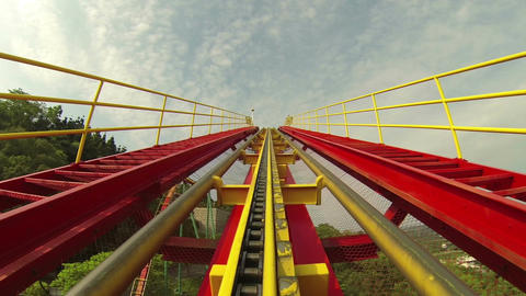 Roller coaster rides up incline on track Footage