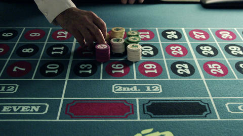 Stacking chips onto a roulette table Footage