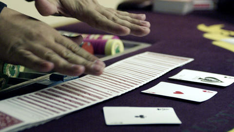 Dealer fanning cards in two hands Footage