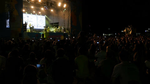 Camera Shows Music Fan Crowd Watching Cool Concert Footage