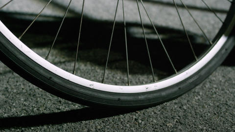Closeup of bike tires skidding to stop Footage