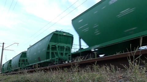 The green freight car is moving along the railway Footage