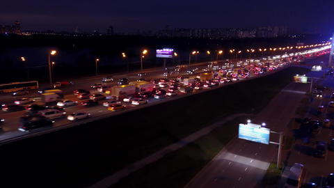 Aerial travelling shot of huge motorway traffic jam in the evening rush hour Footage
