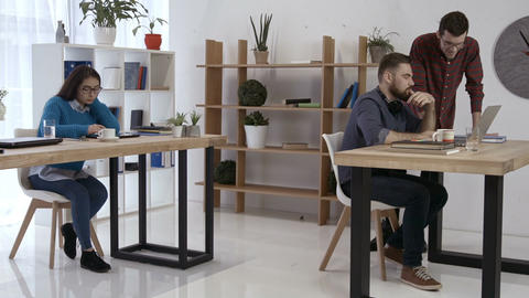 Freelance hipsters talking aboout startup business Footage