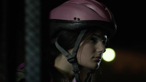 Sliding metal gate opens in front of girl in bicycle helmet Footage