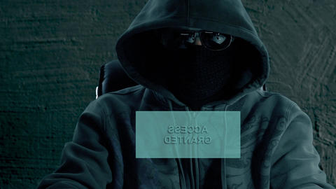 Man hacker sits at night in front of virtual screen and... Stock Video Footage