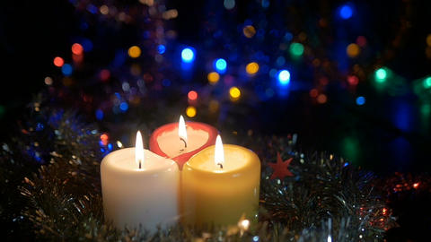 Three New Year candles are burning, they are extinguished with air. The holiday Footage