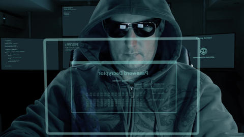 Hacker in hood and dark glasses sits in front of virtual screen and writes code Live Action