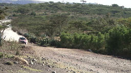 A rally car jumps over a bump in the rural Kenya Archivo