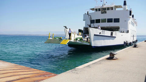PREKO, CROATIA, 12.8.2017:Ferry comes to the port and slowly opens loading ramp Footage