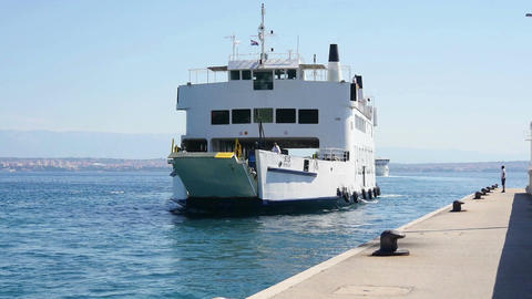 The ferry comes to the port and slowely opens loading ramp Footage