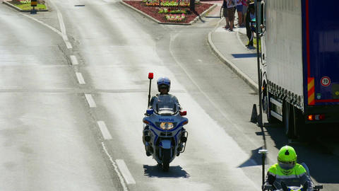 LJUBLJANA, 28.9.2017, Amateur cycling race: Police officers on motorcycles Footage