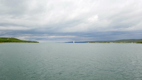 Cloudy seascape of Croatian Adriatic sea with some sailing boats Footage