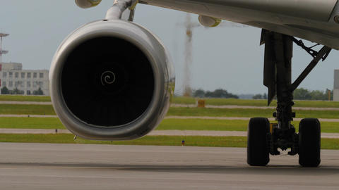 Heat haze behind jet engine and landing gear of taxiing airliner Footage