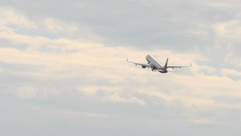 Passanger airplane retracts landing gear after take off and flies away in Image