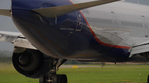 Tail of taxiing 777-300 and heat shimmer from it's engine. Boeing 777 is the Footage