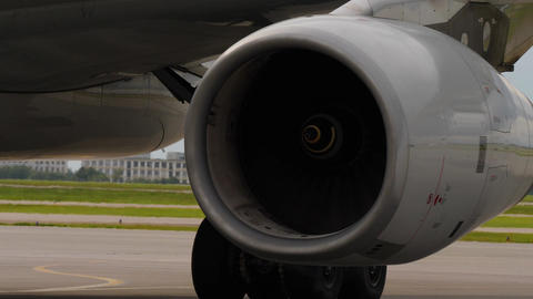 Close up shot of jet airplane engine and heat shimmer behind it Live Action