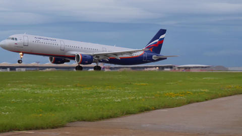 MOSCOW, RUSSIA - JULY 15, 2017: Aeroflot Airbus A321 takes off by runway guard Footage