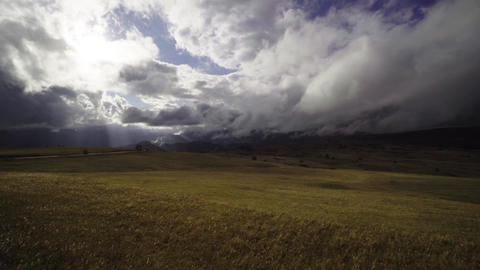 Panning shot of highland plateau and dramatic cloudy sky in Montenegro Footage
