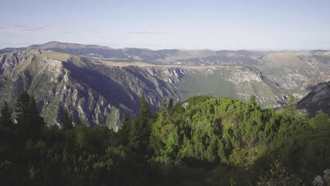 Evergreen forest and rocky ridges of Montenegro mountains. Panning shot Footage
