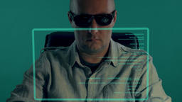 Bald white officer sits in front of virtual screen and typing program code. Man ライブ動画