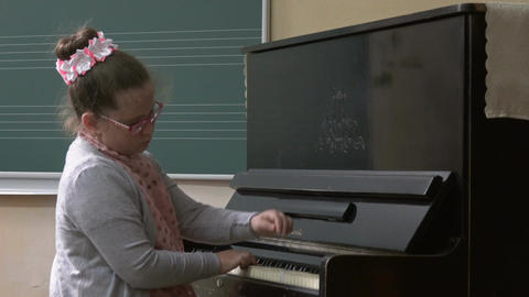 Girl playing piano, music lesson Footage