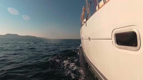 Luxury catamaran boat sailing on the sea towards island Footage