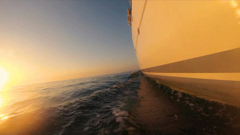 Luxury yacht catamaran sails on the waves at sunset Footage
