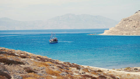 Tourist schooner anchored in Aegean bay near Mykonos island Footage