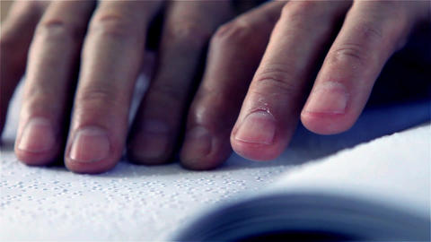 Hands of a Man Reading Braille Footage