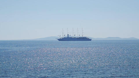 Large cruise ship with five masts silhouette on the horizon Footage