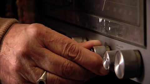 [alt video] Elderly Man Tuning Vintage Radio