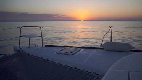 Luxury Catamaran Sailing Through Aegean Sea During Colourful Sunset Footage