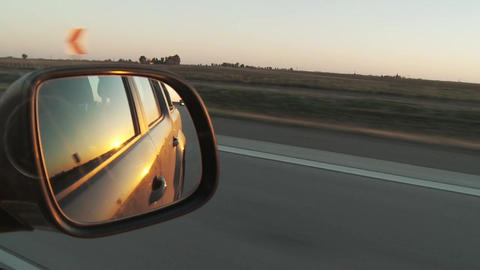 Car Mirror on the Route, at Sunset Live Action