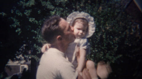 1948: Baby girl runs to dad's embrace and safety loving kisses Footage