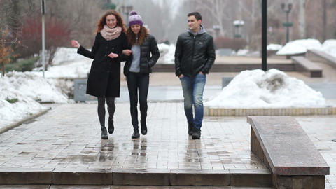 Friends on the walk in winter streets Footage
